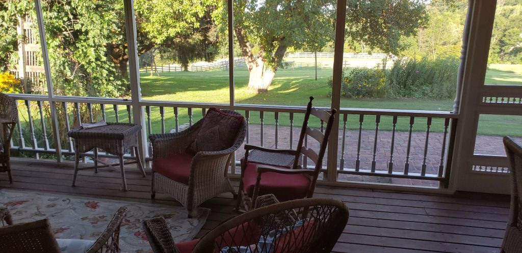 Enjoying a lovely day, with fantastic views from the screened in porch